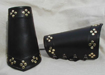 Leather Paladin Bracers shown in black wth brass studs.