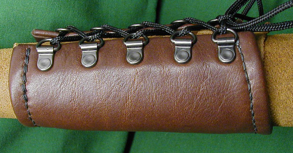 Soft Leather Bracers shown in brown leather with black hand stitching. Excellent comfort.
