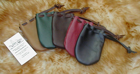 Drawstring Coin Pouches shown in Tan, Green, Brown, Brick & Black.