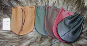 Large Drawstring Pouches shown in Tan, Green, Brown, Brick & Black.
