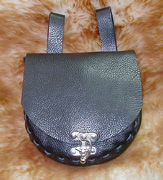 Swinglock Belt Purse shown in black leather with nickel clasp.