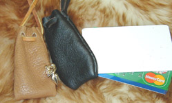 Hand Stitched Reliquary Neck Pouches shown in tan & black leather.